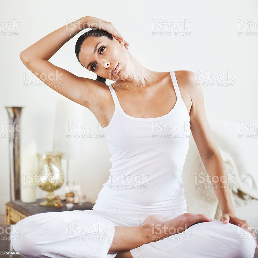 Beautiful young woman practicing yoga on living room. royalty-free stock photo