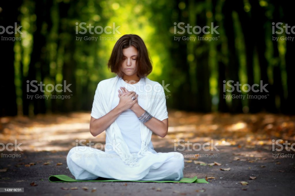 Beautiful young woman practicing yoga royalty-free stock photo