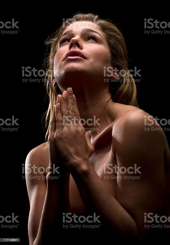 Beautiful young woman praying royalty-free stock photo