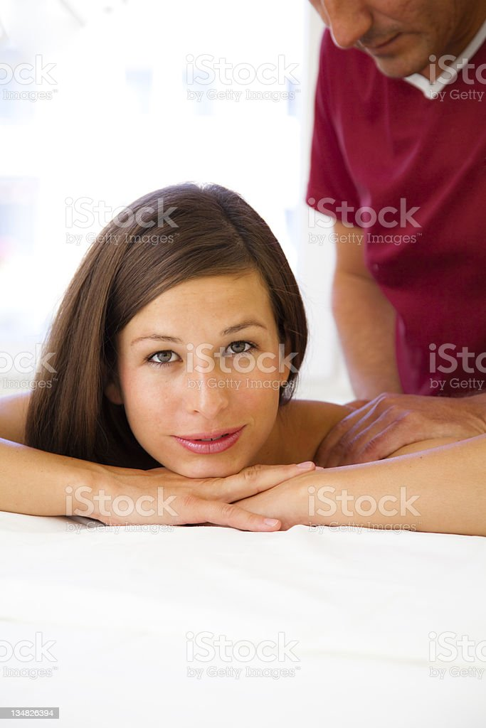 Beautiful young woman receives a massage stock photo