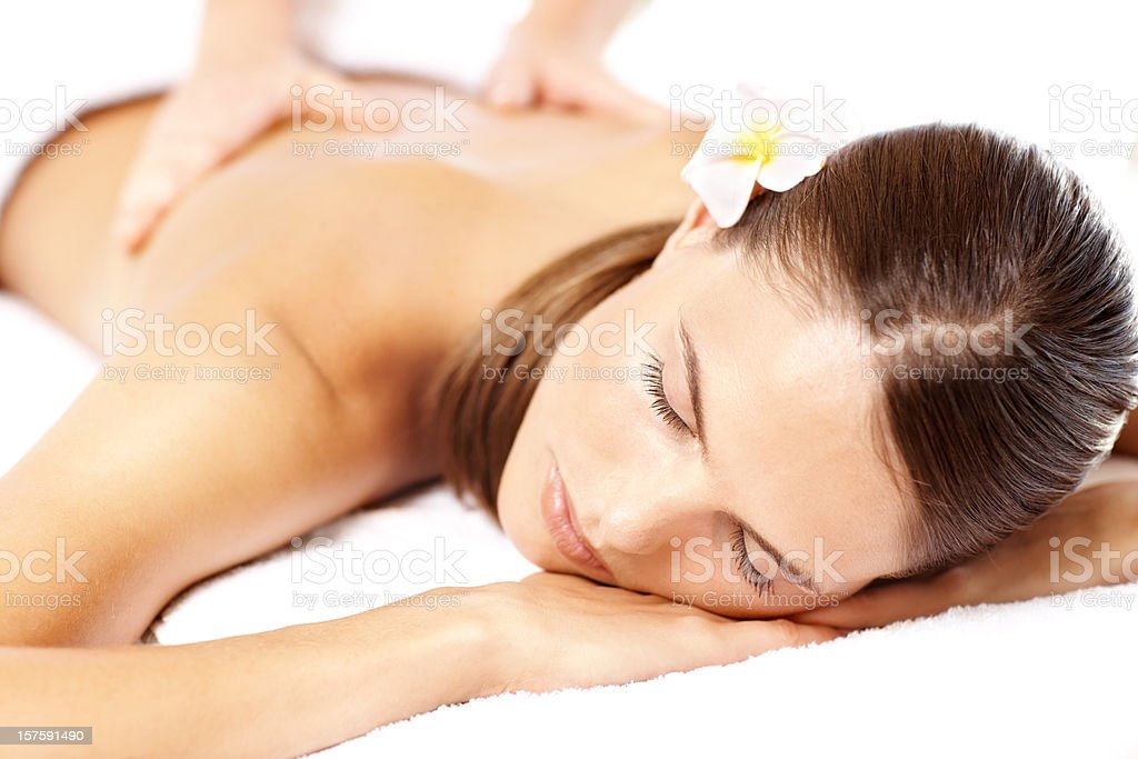 Beautiful young woman receiving back massage at spa royalty-free stock photo
