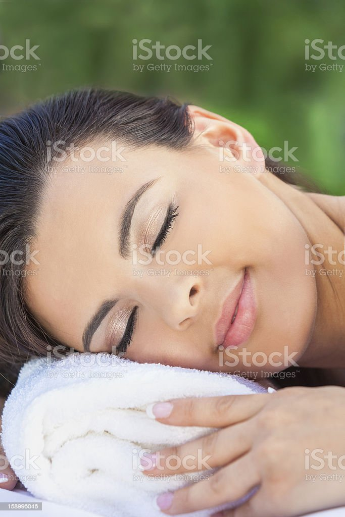 Beautiful Young Woman Relaxing At Health Spa royalty-free stock photo