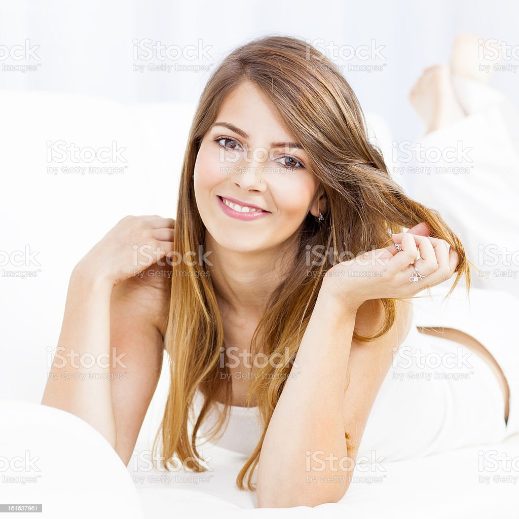 Beautiful young woman relaxing at home royalty-free stock photo