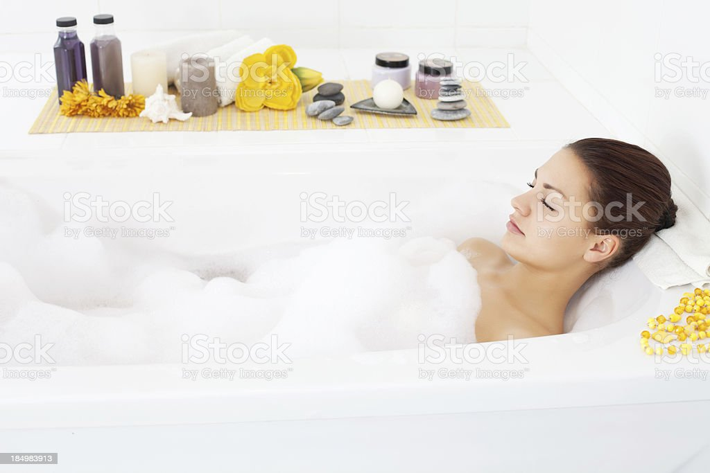 Beautiful young woman relaxing in bathtub. royalty-free stock photo
