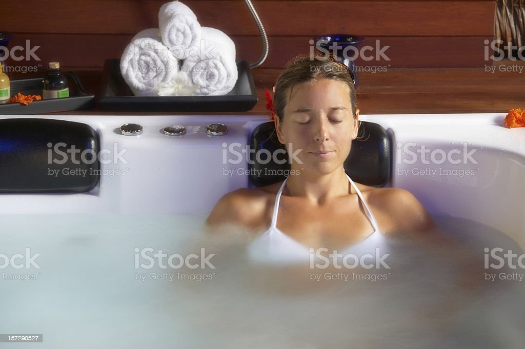 beautiful young woman relaxing in spa royalty-free stock photo
