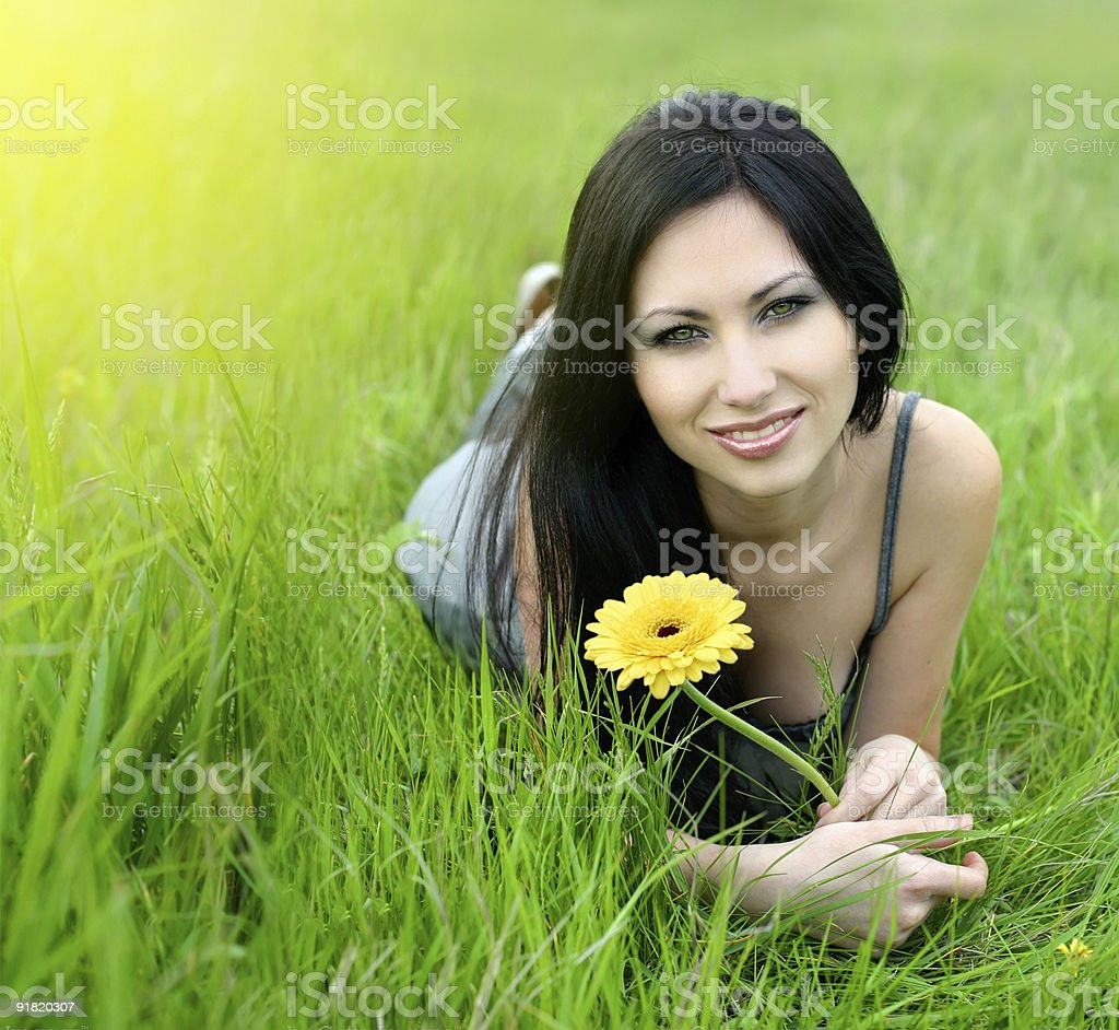 beautiful young woman relaxing in the grass royalty-free stock photo