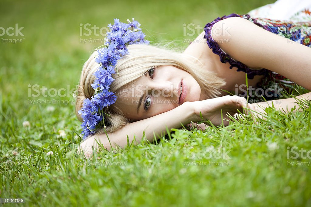 Beautiful Young Woman Relaxing On Grass royalty-free stock photo