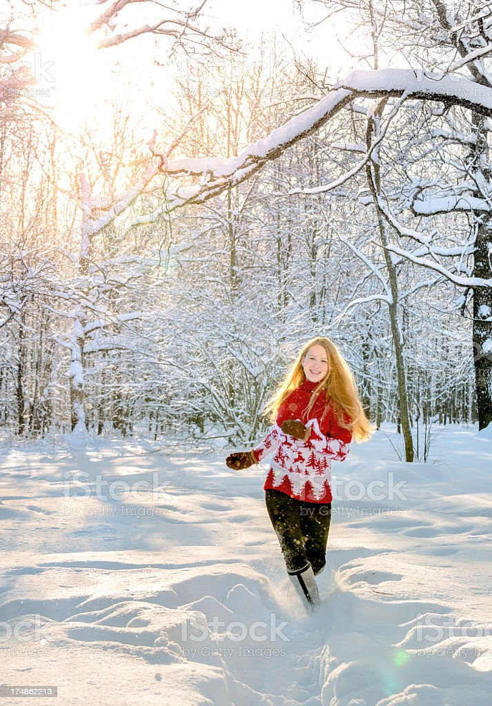 Beautiful young woman running at winter forest royalty-free stock photo