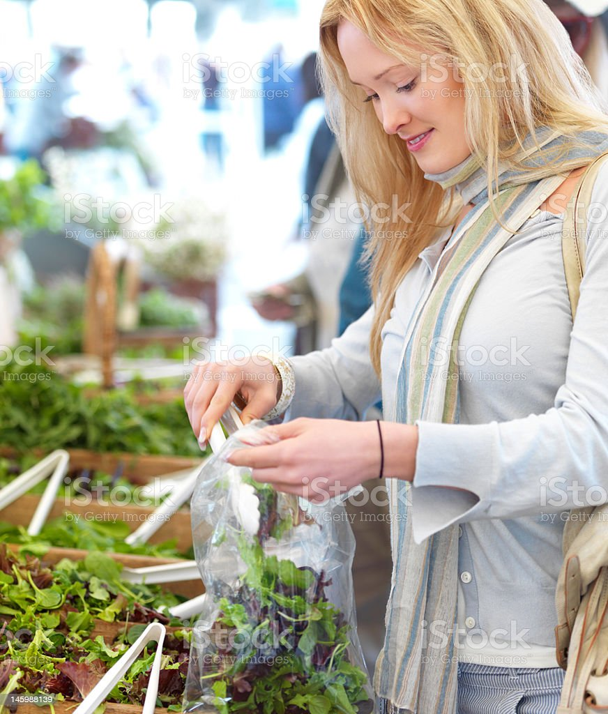 Beautyful young woman shopping for green salad royalty-free stock photo