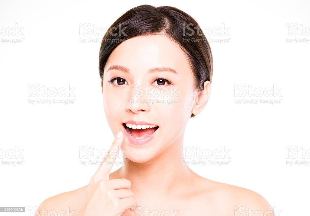 beautiful young woman showing her teeth stock photo