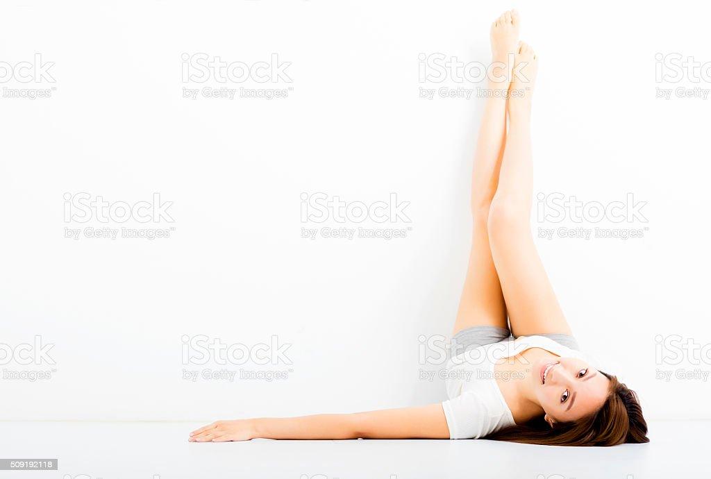 beautiful young woman showing long legs stock photo