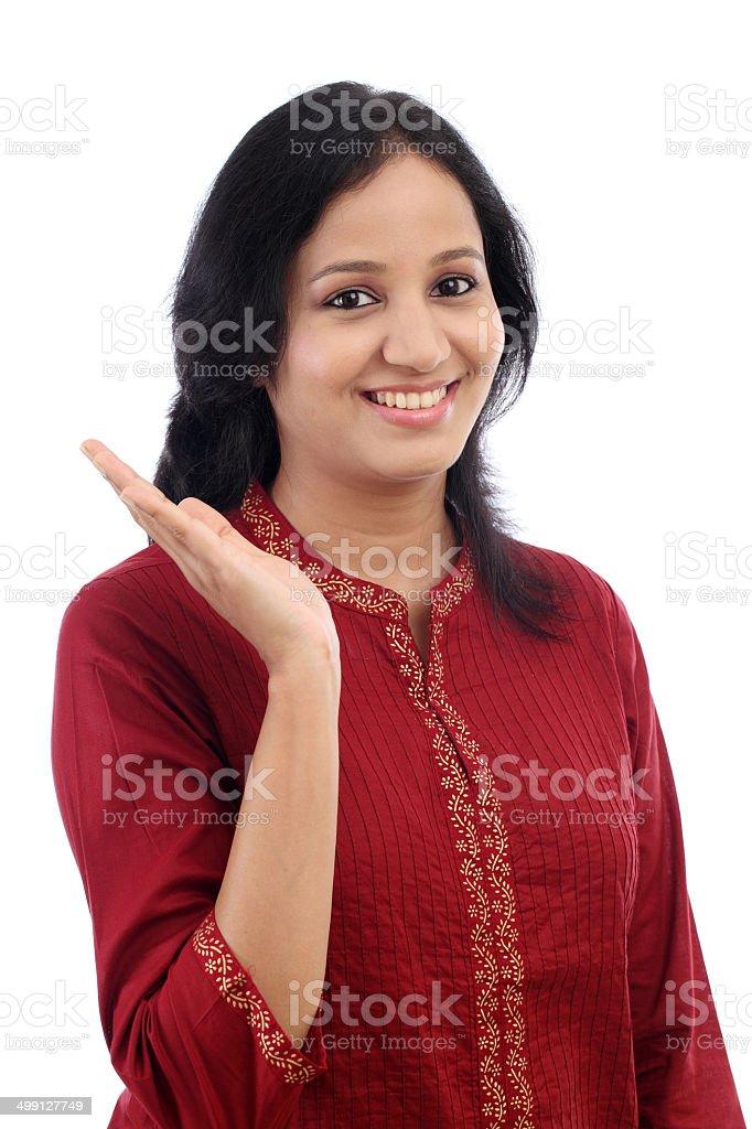 Beautiful young woman showing open palm stock photo