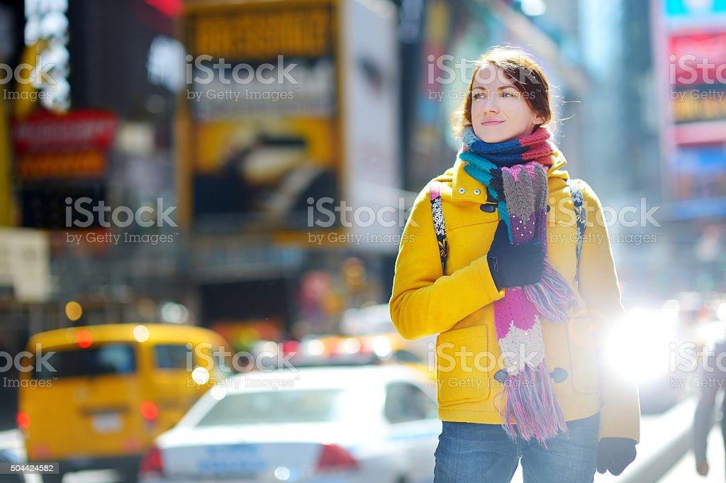 Beautiful young woman sightseeing at Times Square stock photo