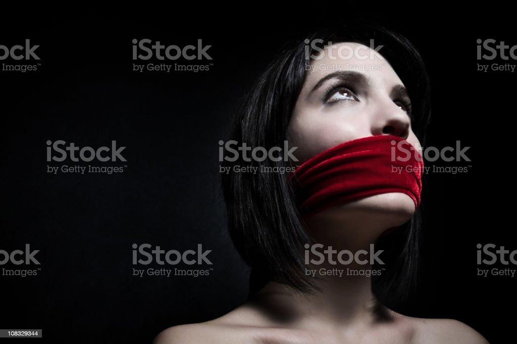 Beautiful young woman silenced royalty-free stock photo