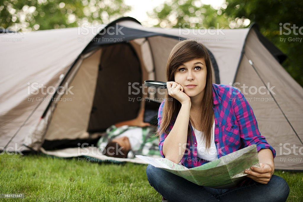 Beautiful young woman sitting in front of tent royalty-free stock photo