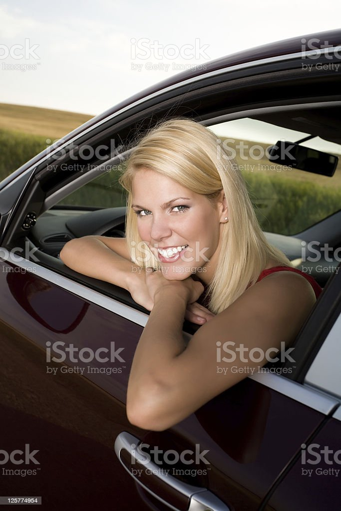 Beautiful young woman sitting in her car royalty-free stock photo