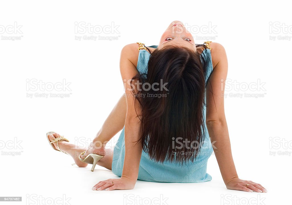 Beautiful young woman sitting on a floor royalty-free stock photo