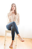 Beautiful young woman sitting on chair