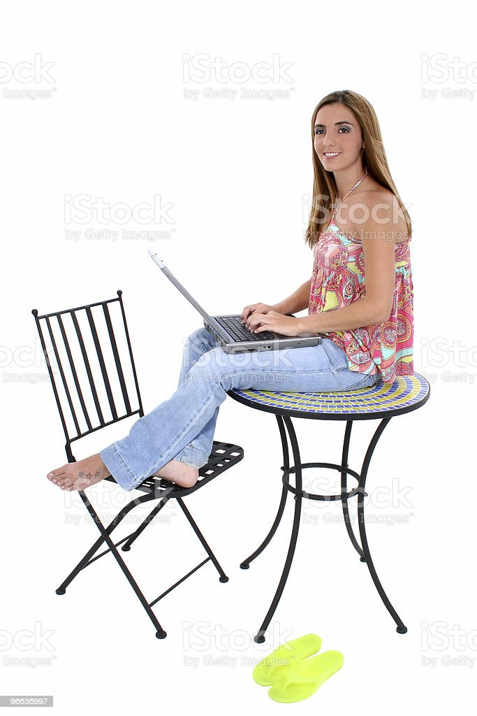 Beautiful Young Woman Sitting On Table royalty-free stock photo