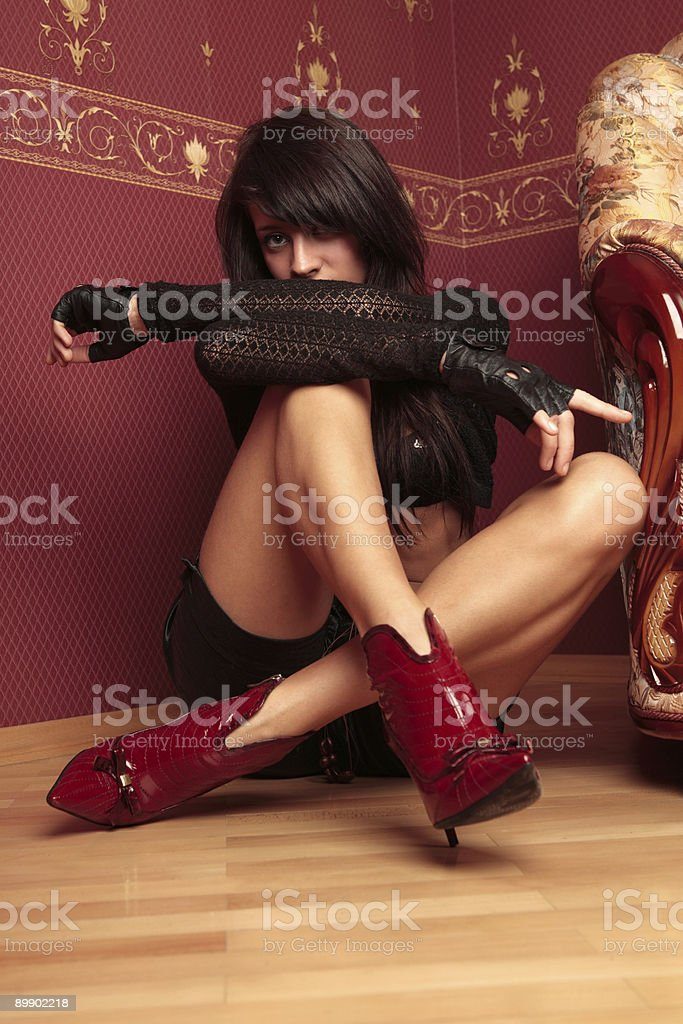 Beautiful young woman sitting on the floor. royalty-free stock photo