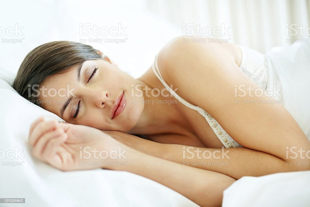 Beautiful young woman sleeping in bed royalty-free stock photo