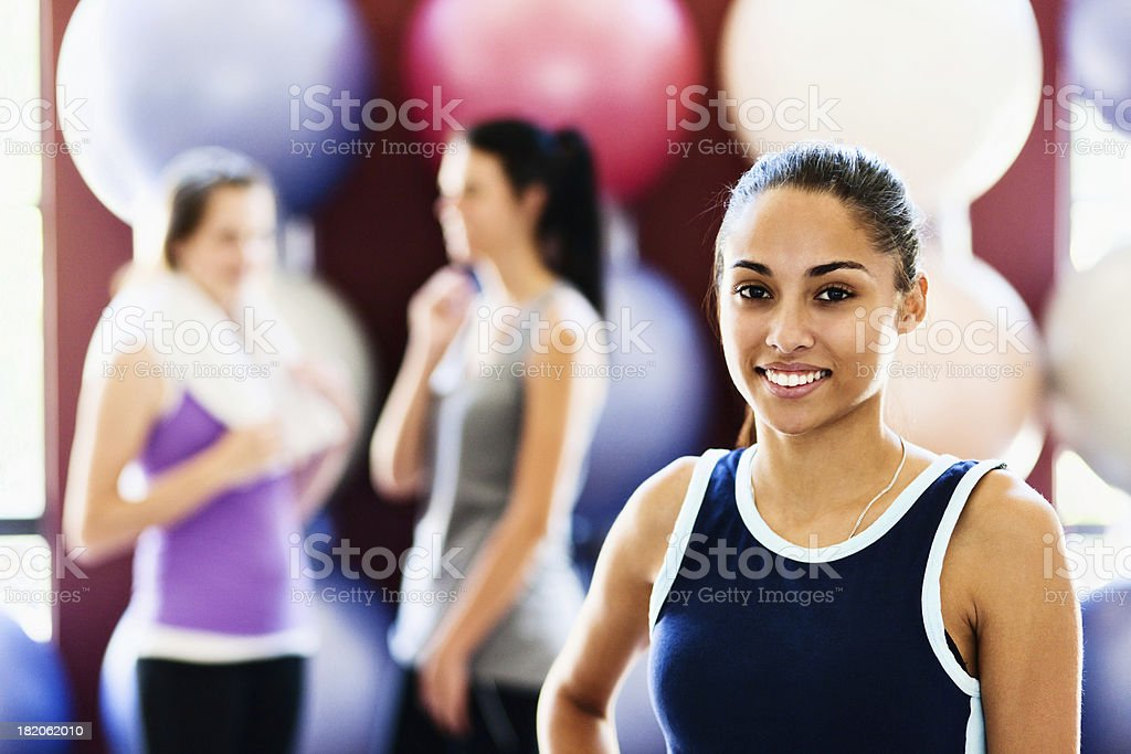 Beautiful young woman smiles after exercise in all-female gym stock photo