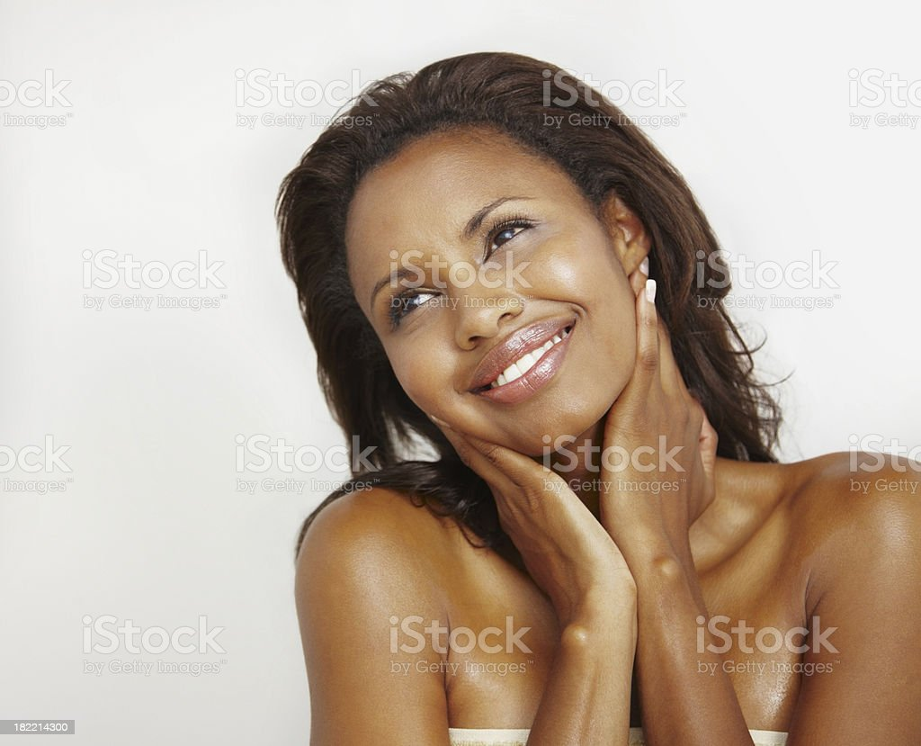 Beautiful young woman smiling and looking away royalty-free stock photo