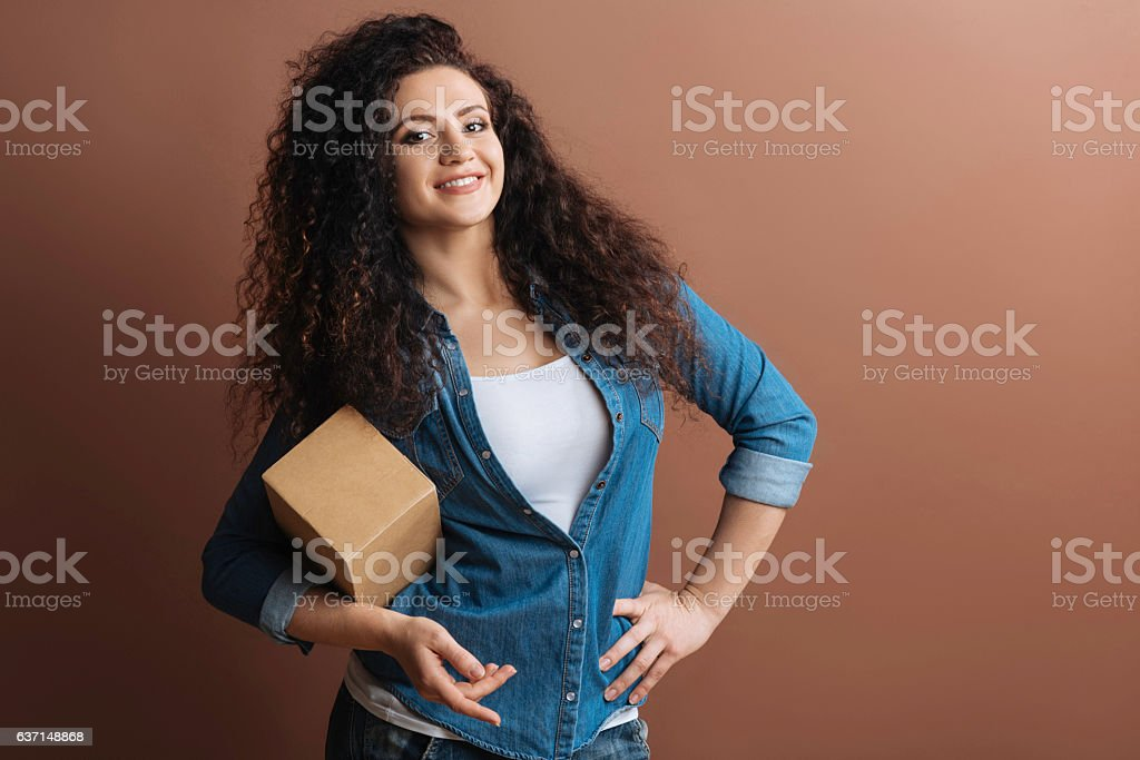 Beautiful young woman smiling at camera stock photo