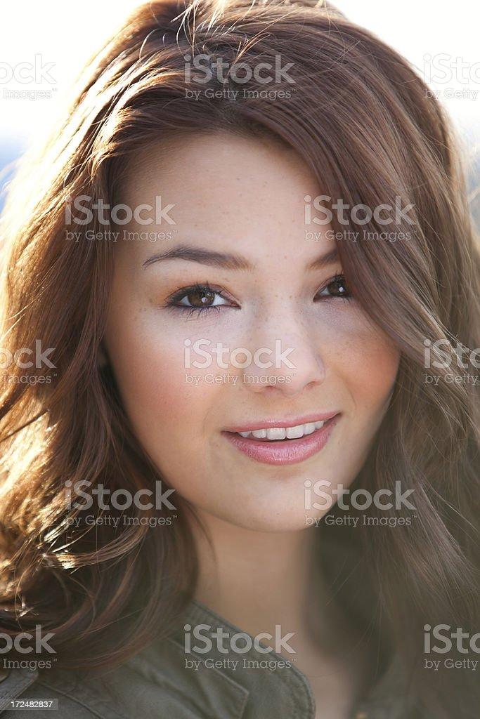 Beautiful young woman smiling headshot royalty-free stock photo