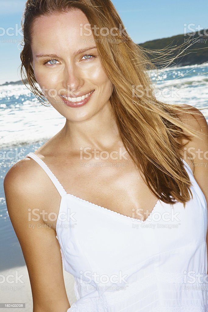 Beautiful young woman smiling on the beach royalty-free stock photo