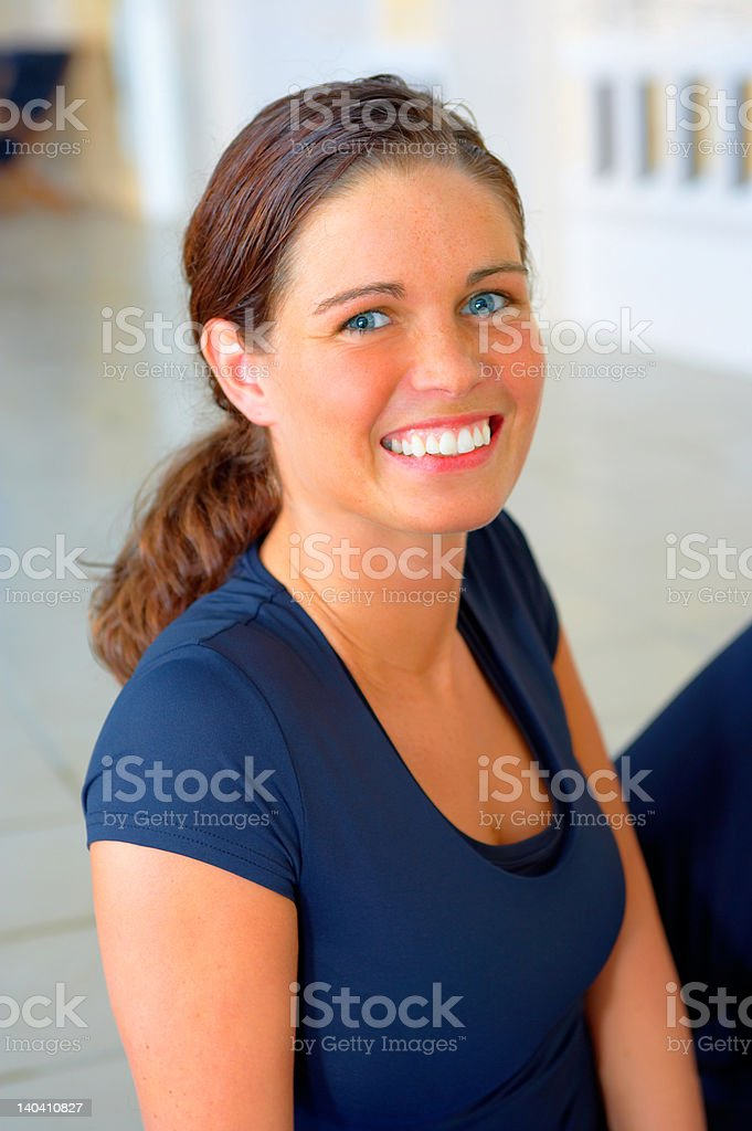 Beautiful young woman smiling while exercising royalty-free stock photo