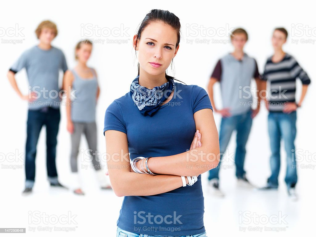 Beautiful young woman standing and friends in background royalty-free stock photo