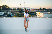 Beautiful young woman standing on rooftop