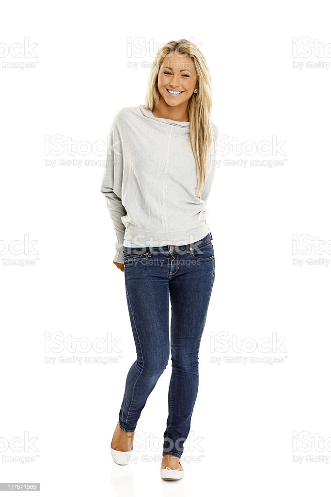 Beautiful young woman standing on white royalty-free stock photo