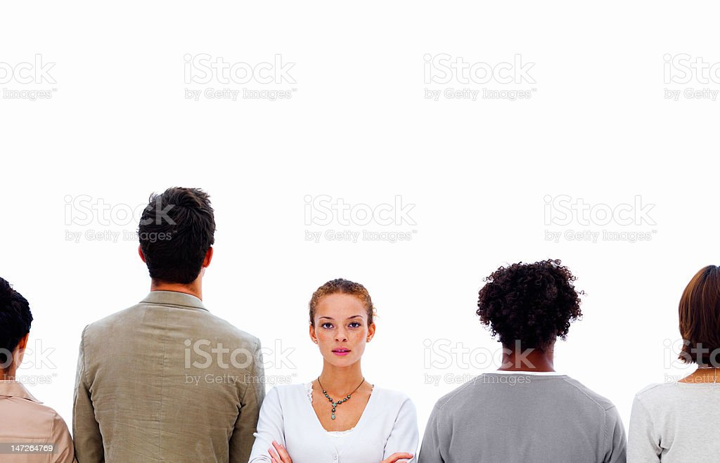 Beautiful young woman standing with friends royalty-free stock photo