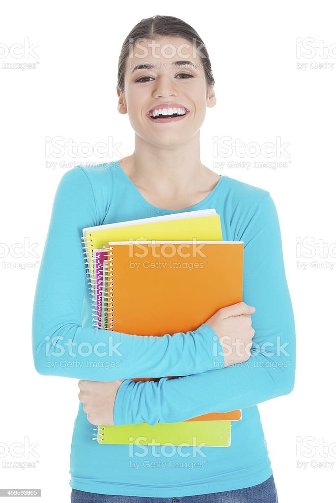 Beautiful young woman student with workbook. stock photo