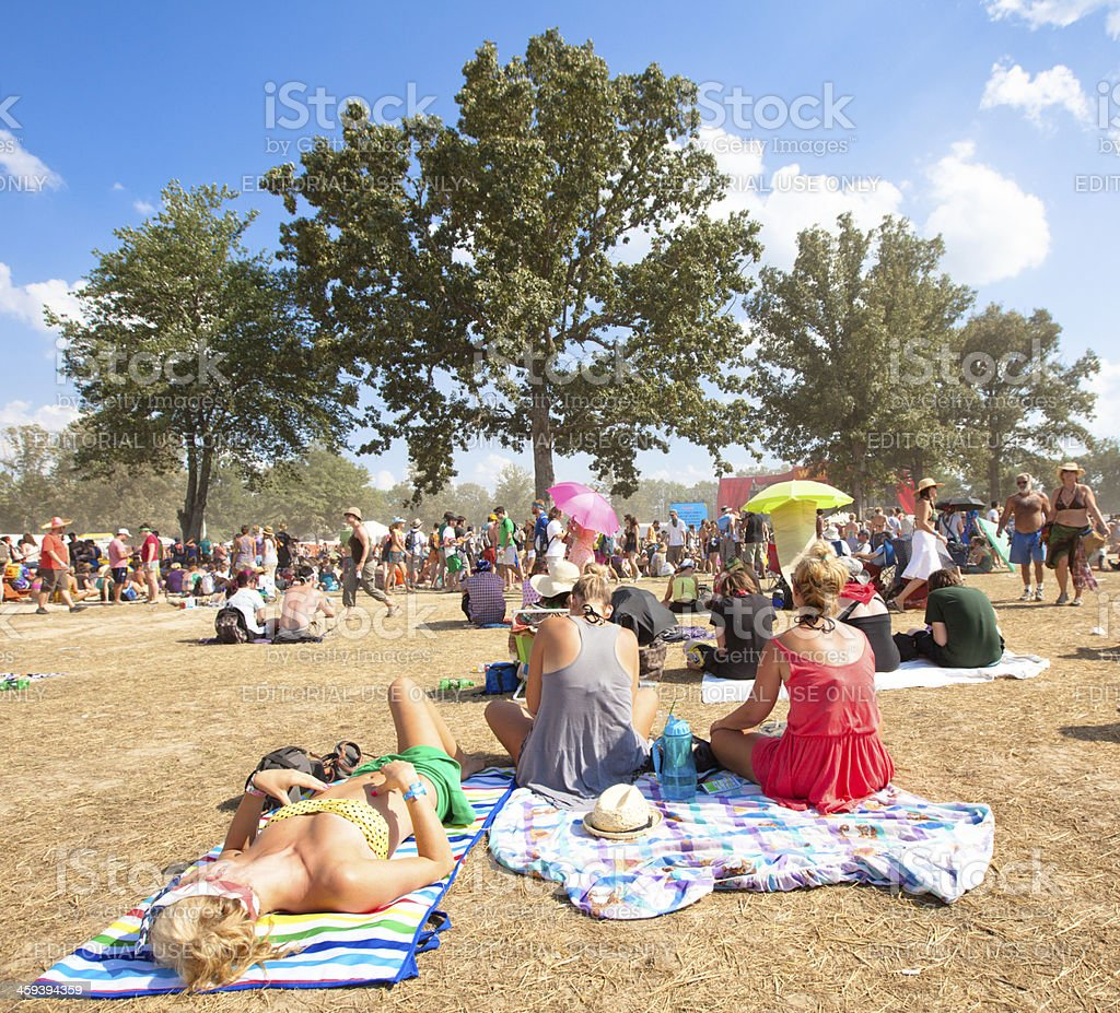 Beautiful young woman sun bathing at music festival royalty-free stock photo