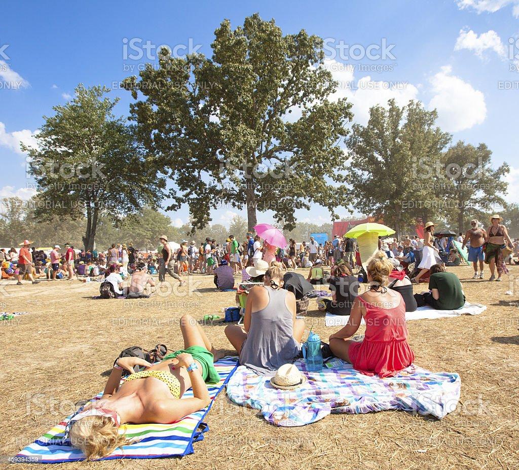 Beautiful young woman sun bathing at music festival stock photo