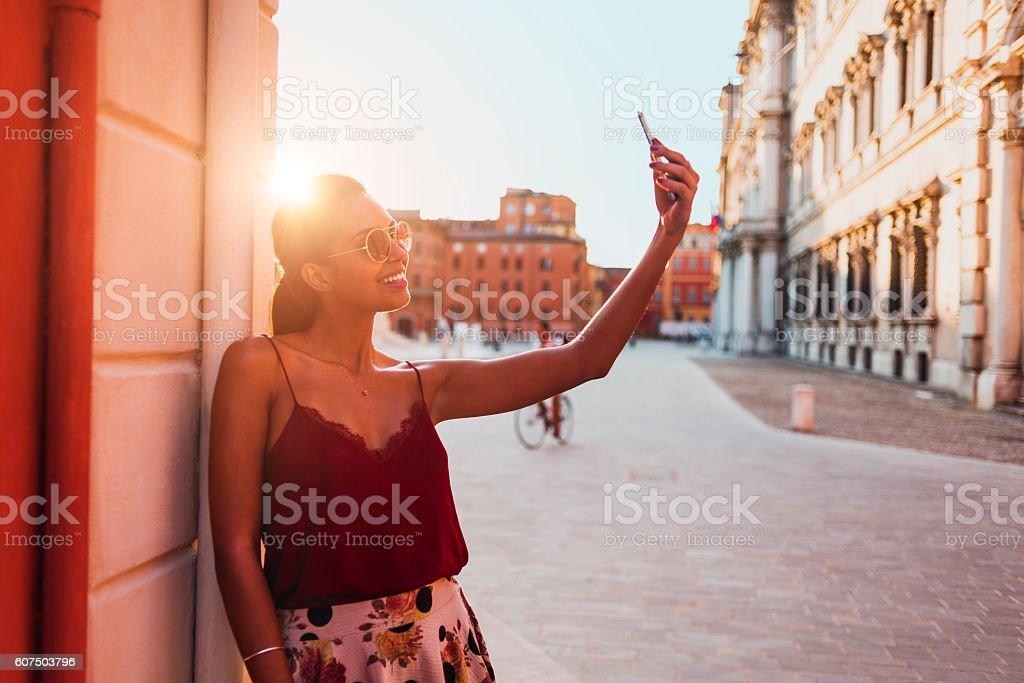 beautiful young woman taking a selfie stock photo