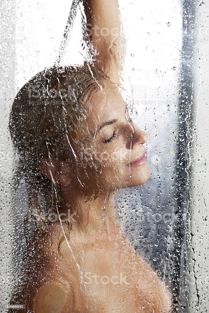 Beautiful young woman taking a shower. royalty-free stock photo