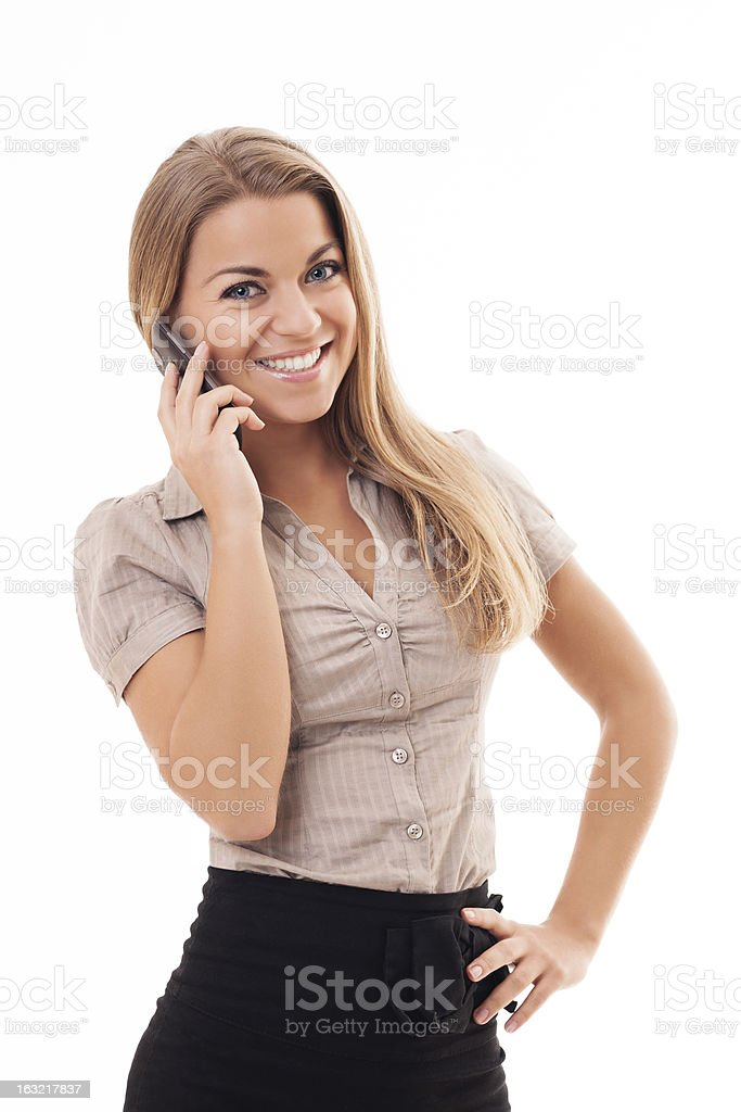 Beautiful young woman talking on mobile phone royalty-free stock photo