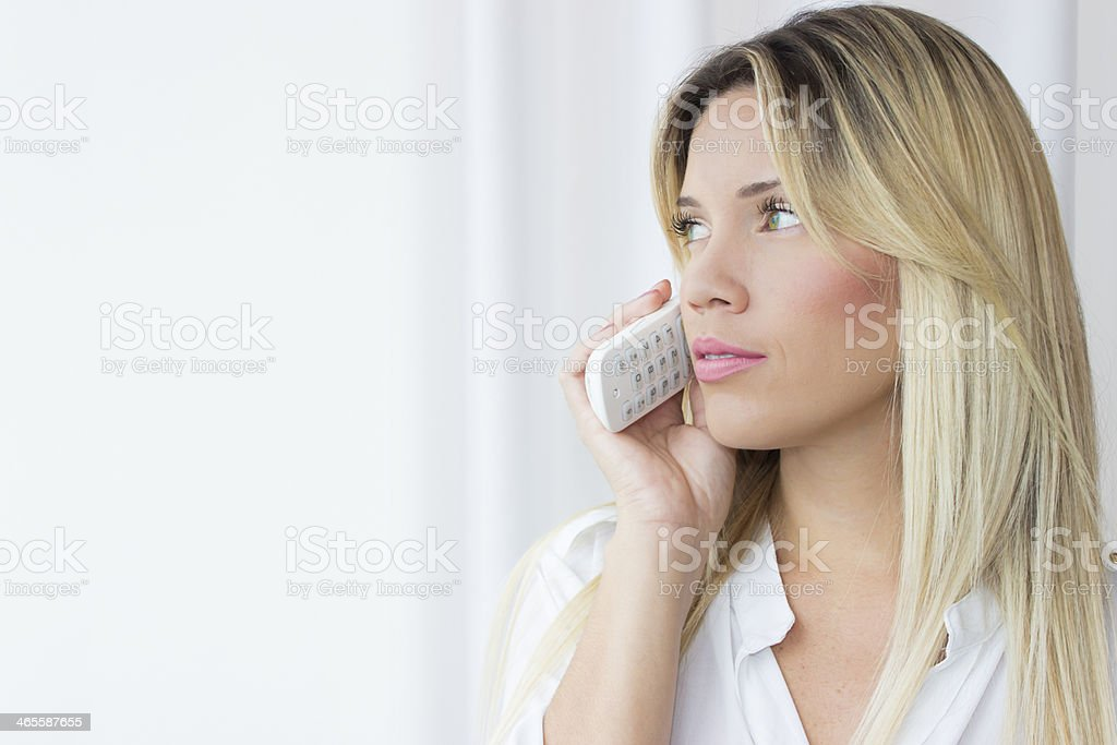 Beautiful young woman  talking on phone royalty-free stock photo
