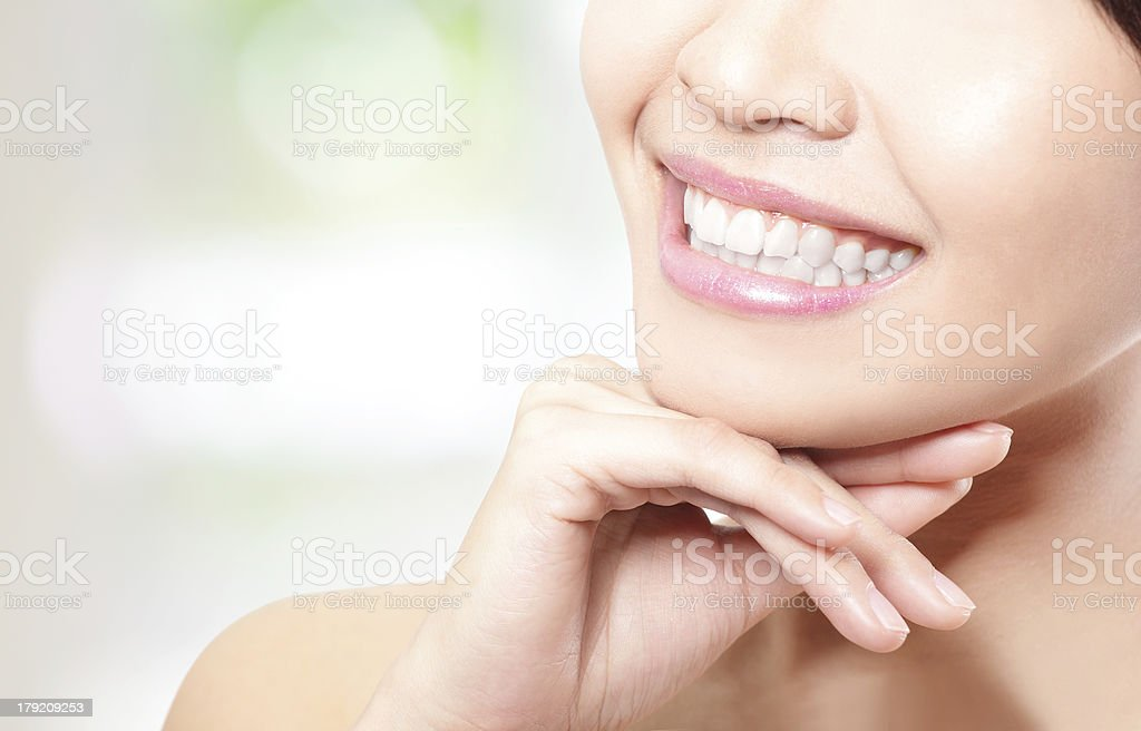 Beautiful young woman teeth close up stock photo