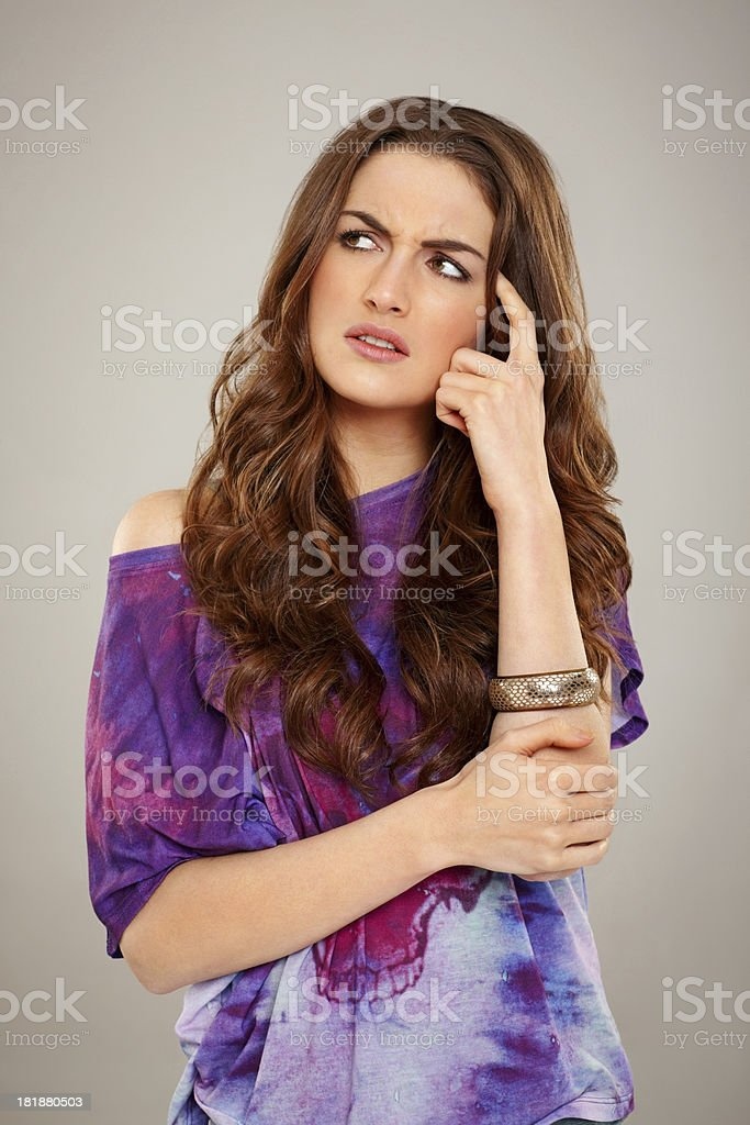 Beautiful young woman thinking royalty-free stock photo