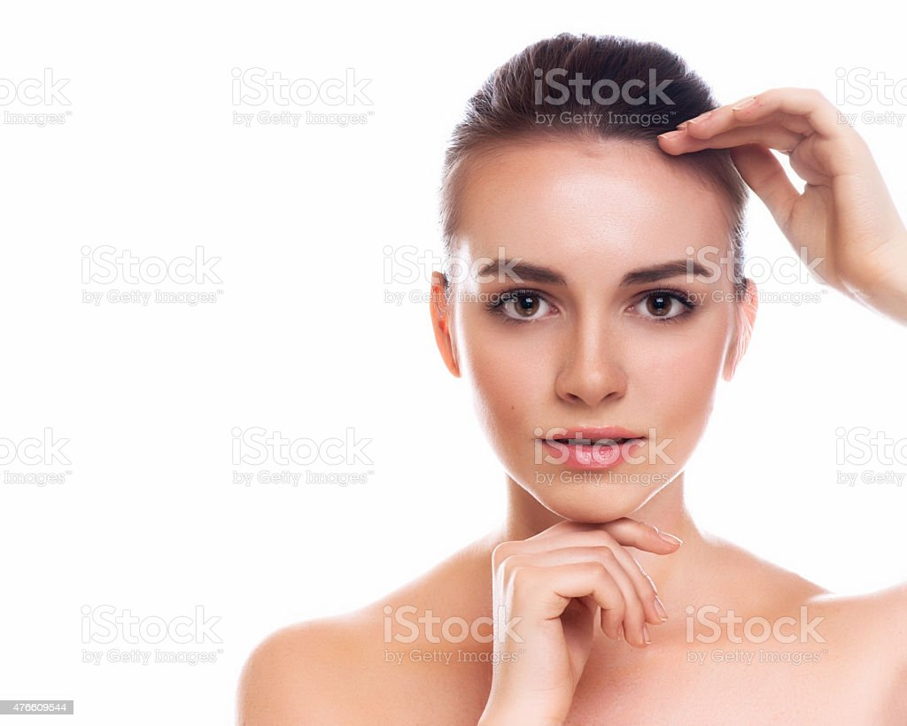 Beautiful Young Woman Touching Her Face.Fresh Healthy Skin. stock photo