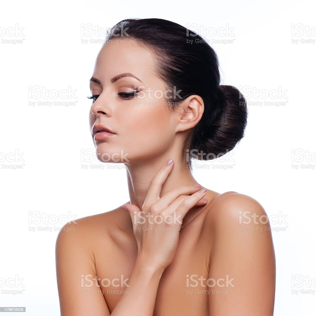 Beautiful Young Woman Touching Her Face.Fresh Healthy Skin.Isolated on White stock photo