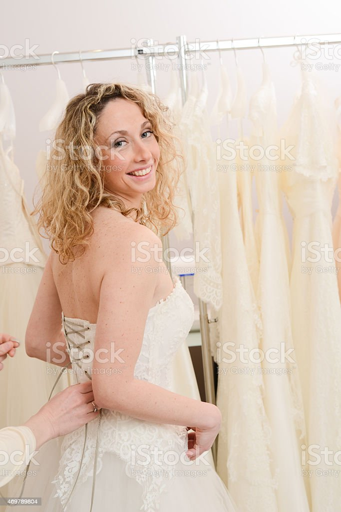 Beautiful Young Woman Trying A Wedding Dress In Bridal Shop Stock