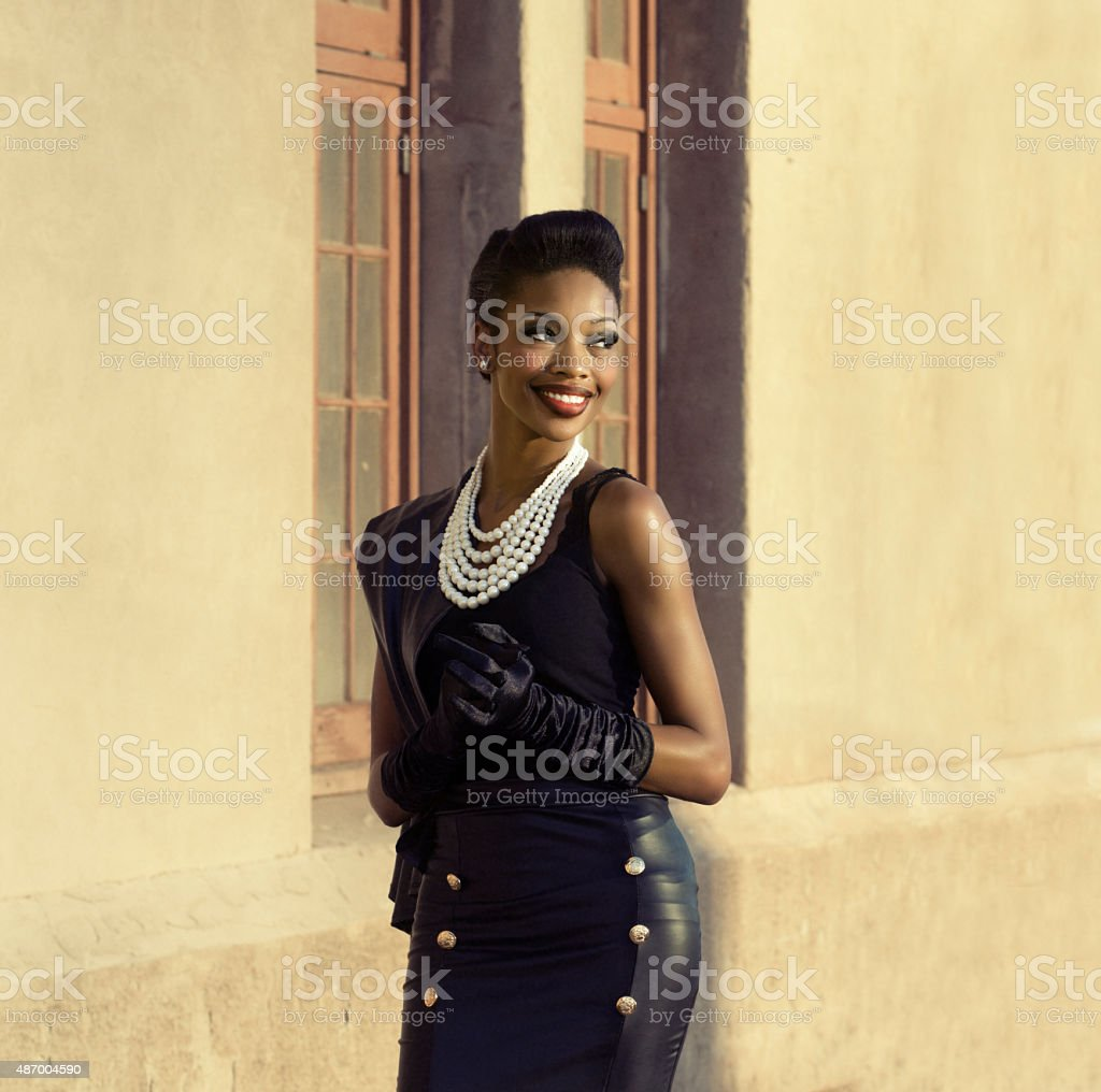 Beautiful young woman turning head stock photo