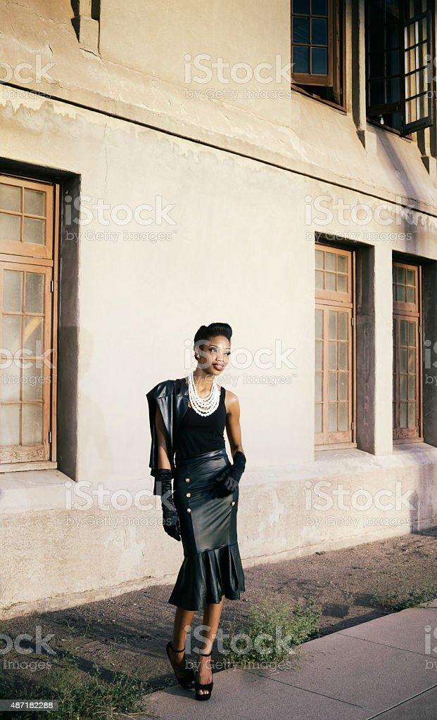 Beautiful young woman turning head stock photo