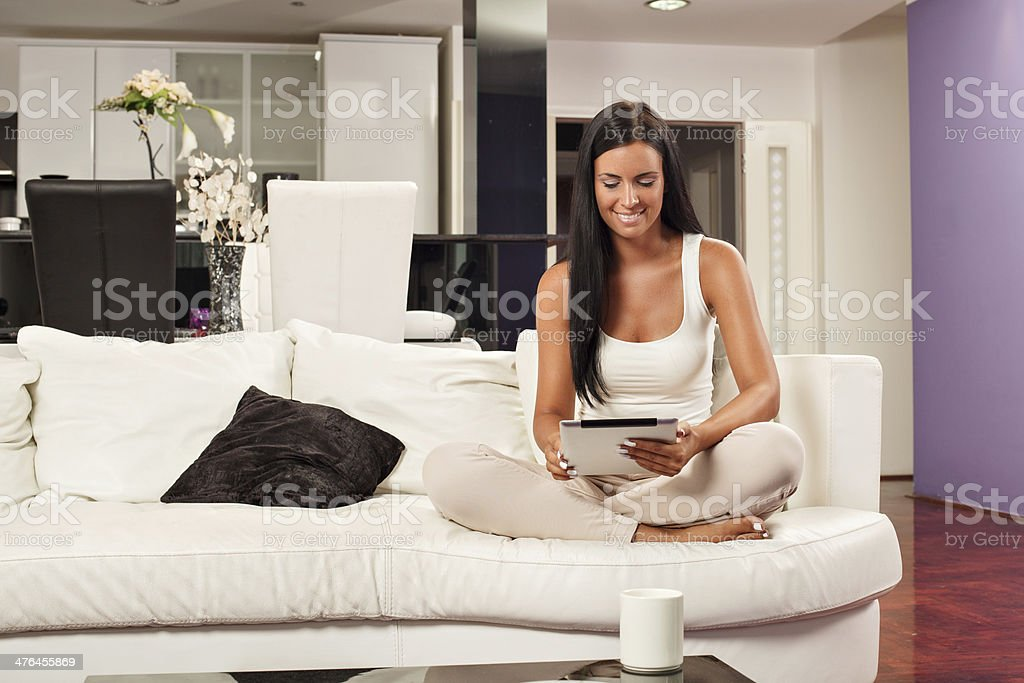 Beautiful young woman using a digital tablet royalty-free stock photo